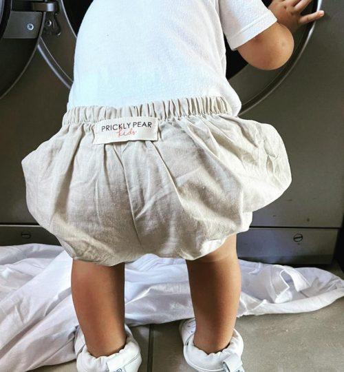 Jaxson climbing into the tumble dryer
